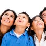 Happy family daydreaming — Stock Photo