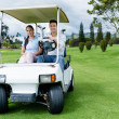 Couple in a golf cart — Stock Photo #32476757