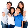 Happy family with thumbs up — Stockfoto