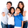 图库照片: Happy family with thumbs up