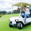 Players in a golf cart — Stock Photo