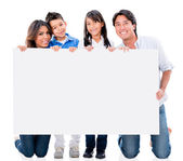 Happy family with a placard — Foto de Stock