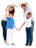 Loving family making a heart — Stock Photo