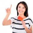 Stock Photo: Woman with a debit card clicking