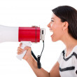 Stock Photo: Womyelling through loudspeaker
