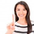 Woman pointing with her finger — Stock Photo