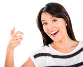 Surprised woman holding something — Stock Photo