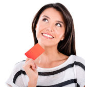 Thoughtful woman with a credit card — Stock Photo
