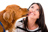 Dog kissing a woman — Stock Photo