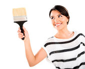 Woman painting with a brush — Stock Photo