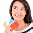 Stock Photo: Pensive woman with credit cards