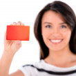 Woman holding a loyalty card — Stock Photo