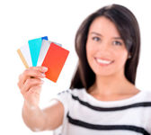 Woman with a handful of cards — Stock Photo