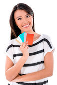 Woman holding credit cards — Stock Photo