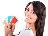 Woman with a handful of credit cards — Stock Photo