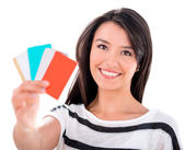 Woman with credit and debit cards — Stock Photo