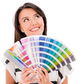 Thoughtful woman with a color guide — Stock Photo