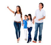 Family walking an pointing away — Stockfoto