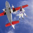 Skydivers jumping out of an airplane. — Stock Photo #50344767