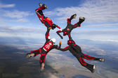 Skydivers collects figure in freefall. — Stock Photo