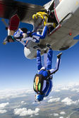 Skydivers jumping out of an airplane. — Stok fotoğraf