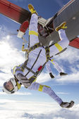 Skydivers jumping out of airplane — Stock Photo