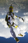 Skydiver performs figure — Stock Photo
