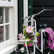 Bicycle with flowers — Stock Photo #11971741