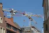 Cranes above buildings — Stock Photo