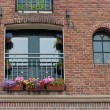 Window with flower boxes — Stock Photo