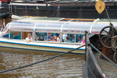 Tourists in sightseeing boat — Stockfoto