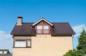 House with balcony — Stockfoto