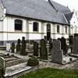 Graveyard with church — Stock Photo