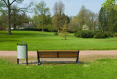 Bench in a park — Photo