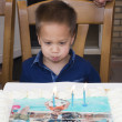 Stock Photo: Little boy with birthday cake