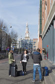 Tourists in amsterdam — Stock Photo