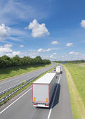 Highway with trucks — Stock Photo