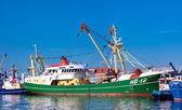 Fishing boats in harbor — Stock Photo