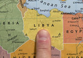 Finger Pointing To Libya On A Map — Stock Photo