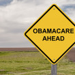 Stock Photo: ObamaCare Ahead - Caution Sign