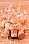Champagne corks and gold glitter decoration — Stock Photo