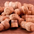 Champagne corks on a wooden table — Stock Photo #13172518