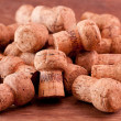 Champagne corks on a wooden table - Stock Photo
