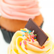 Vanilla cupcake topping close up - Stock Photo