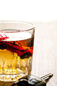 Toy car in a glass of whisky close up — Stockfoto
