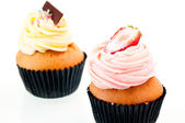 Strawberry and vanilla cupcake close up — Stock Photo