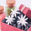 Wellness gift in a red box with balck zen stones and bath salts — Stock Photo
