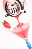 Strawberry Daiquiri being poured into a glass — Stock Photo