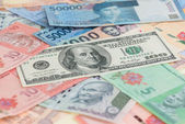 US one hundred dollar bill and Asian currencies close up — Stock Photo