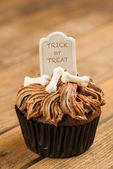 Halloween cupcake with Trick or Treat wording on the tombstone topper close-up — Stock Photo